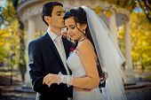Sensual Wedding Outdoor Portrait. The Stylish Groom Is Tenderly Hugging And Kissing His Gorgeous Lov poster