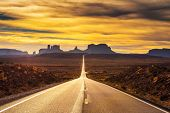 Desert Road Leading To Monument Valley Photographed At The Forrest Gump Point With Dramatic Sunset S poster