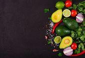 Guacamole Sauce Ingredients - Avocado, Tomato, Onion, Pepper Chili, Garlic, Cilantro, Lime On Black poster