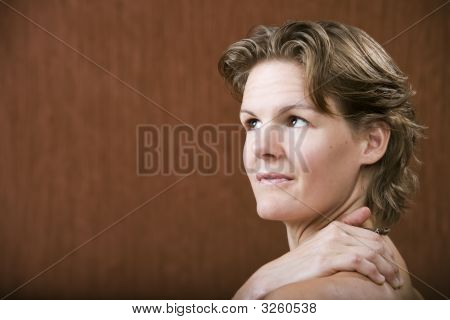 Woman With Her Hand On Her Shoulder