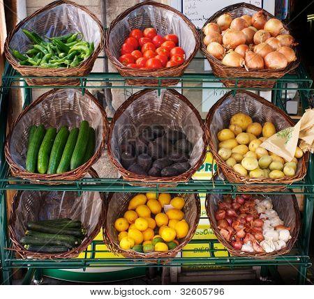 Vegetables in baskets on market place.