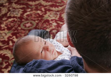 Adult Man And Newborn Baby