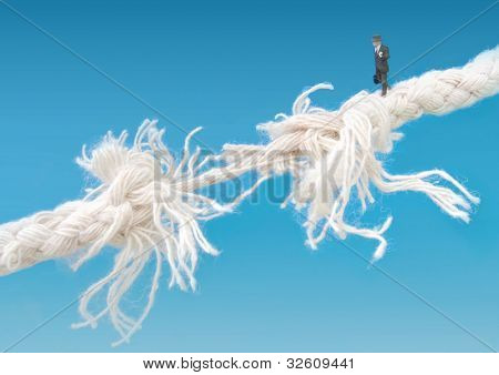 Businessman Walking Tightrope