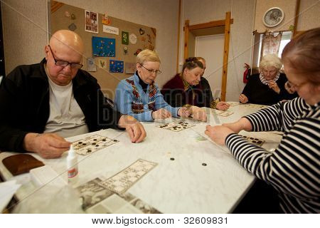 PODPOROZHYE, RUSSIA - MAY 3: Day of Health in Center of social services for pensioners and disabled (Lotto - exercises for development of attention for eldery), May 3, 2012 in Podporozhye, Russia.