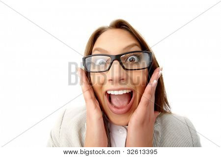 Close-up portrait of a girl in formal wear with funny look as if shocked or enormously excited
