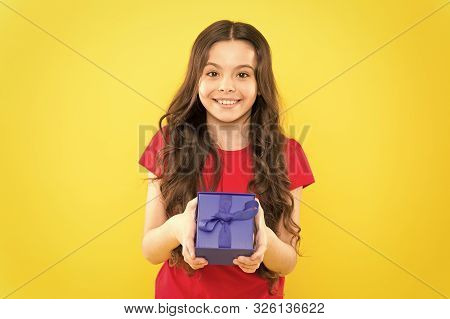 poster of Happy Birthday To You. Birthday Girl. Happy Little Child Holding Birthday Gift On Yellow Background.