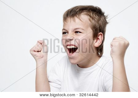 Happy boy football fan on light background