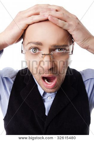 Bald young man with hands on head stressed mouth open
