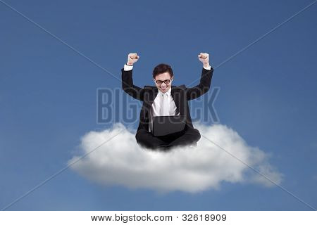 Cloud Computing: Happy Businessman With Laptop