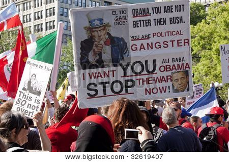 NEW YORK - MAY 1: A protester holds a sign that pictures President Obama and Uncle Sam in Union Square at the Occupy Wall St 'May Day' protests on May 1, 2012 in New York, NY.
