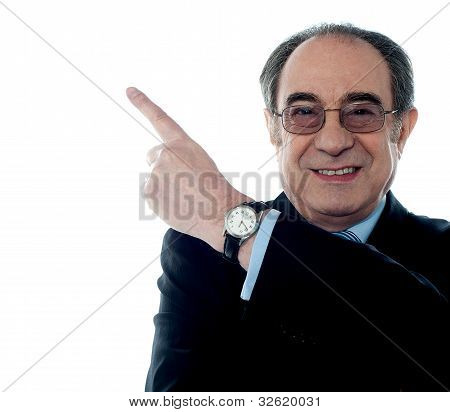 Caucasian Old Businessman Pointing Upwards