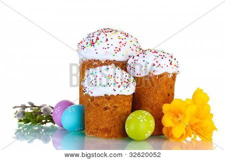 Beautiful Easter cakes, colorful eggs and flowers isolated on white