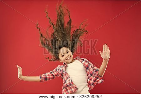 poster of Amazing Long Hair. Cute Small Girl With Long Hair Curls Waving On Red Background. Adorable Little Ch
