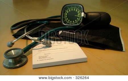 Doctors Script Pad, Stethoscope And Sphygmomanometer