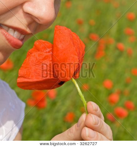 Happy Woman Smile With Poppy