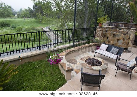 Backyard on the golf course - custom landscaping including firepit and water feature