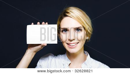 Young Woman Holding Up A Blank Card