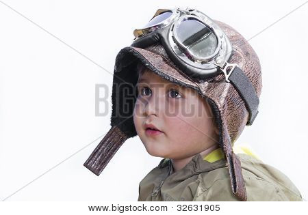 A little cute baby dreams of becoming a pilot. Pilot outfit, hat and glasses