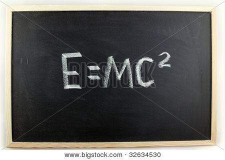 Formula written in chalk on blackboard