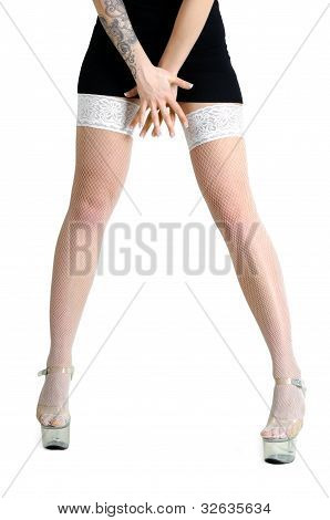 Conceptual Image Of Young Tattooed Woman In White Panty-hose