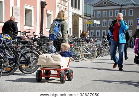 Tourists visiting the beautiful city Salzburg, Austria
