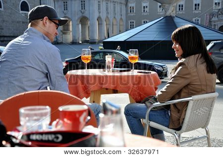 Tourists relaxing in the historical center of Salzburg