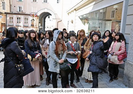 A group of Japanese tourists in Salzburg, Austria