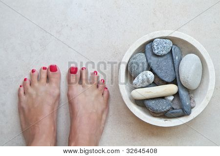 Feet And Zen Stones At A Spa