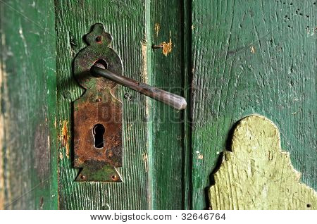 A Very Old Door Handle On A Wooden Door