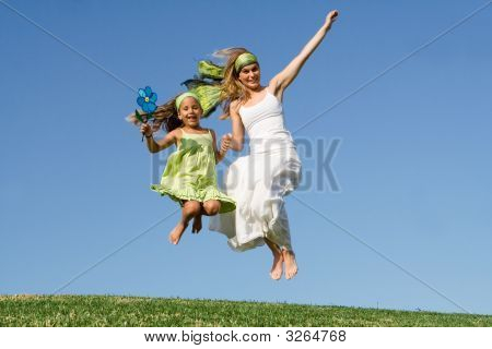Happy Family  Mother And Child Jumping