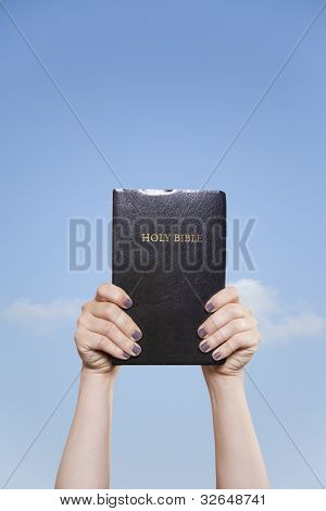 Holding The Bible High In The Sky