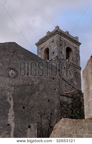 Old church belfry in Savoca village Sicily Italy in the evening