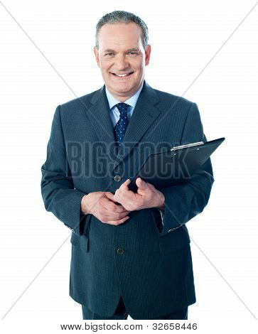 Smiling Elderly Businessman Holding Clipboard