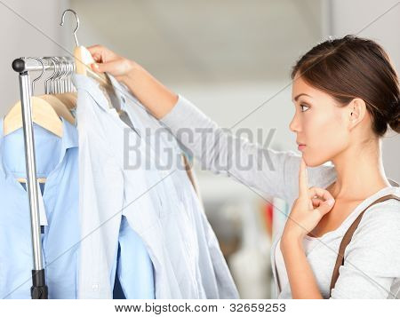 Shopper Choosing Clothes Thinking