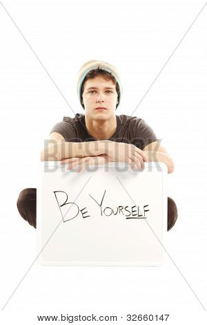 Young Man Dressed In Hip Style Holding Sign