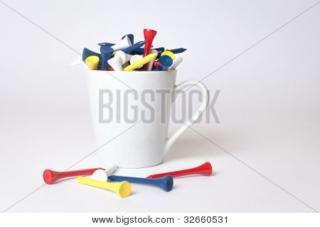 Stack of colourful golfing tees isolated on white background