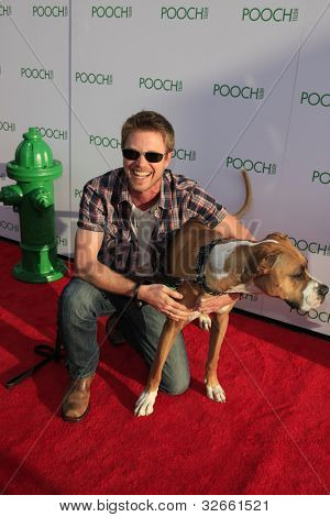 LOS ANGELES, CA - MAY 3: Kaj-Erik Eriksen, dog Hazel at the grand opening of the Pooch Hotel on May 3, 2012 in Hollywood, Los Angeles, California.