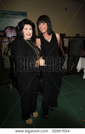 LOS ANGELES, CA - MAY 3: Barbara Van Orden, Kim Rhodes at the grand opening of the Pooch Hotel on May 3, 2012 in Hollywood, Los Angeles, California.