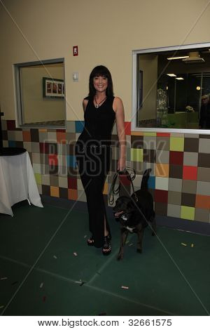 LOS ANGELES, CA - MAY 3: Kim Rhodes at the grand opening of the Pooch Hotel on May 3, 2012 in Hollywood, Los Angeles, CA. The Pooch Hotel is billed as a luxury hotel and daycare exclusively for dogs.