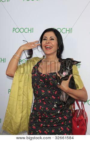LOS ANGELES, CA - MAY 3: Maria Conchita Alonso at the opening of the Pooch Hotel on May 3, 2012 in Hollywood, Los Angeles, CA. The Pooch Hotel is a luxury hotel and daycare exclusively for dogs.