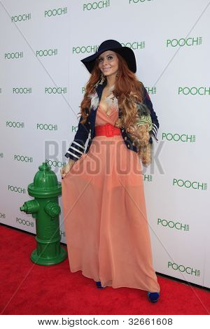 LOS ANGELES, CA - MAY 3: Phoebe Price, dog Henry at the opening of the Pooch Hotel on May 3, 2012 in Hollywood, Los Angeles, CA. The Pooch Hotel is a luxury hotel and daycare exclusively for dogs.