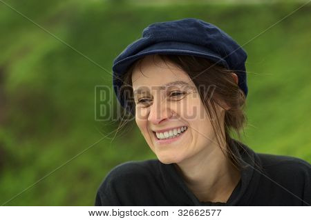 Smiling Young Woman with Cap