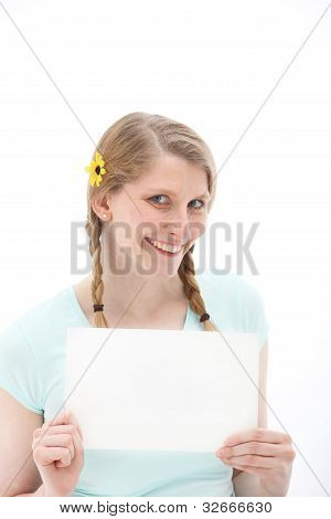 Pretty Blonde Holding Up A Blank Sheet Of Paper