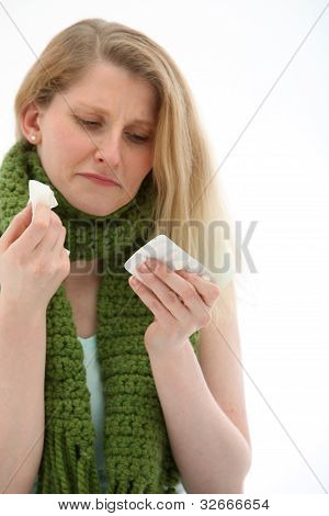 Young Girl Feeling The Misery Of A Bad Head Cold