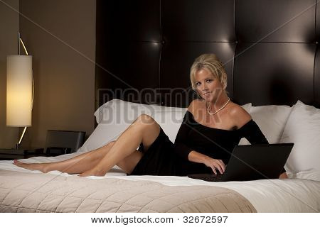 Woman Relaxing in a Hotel Room