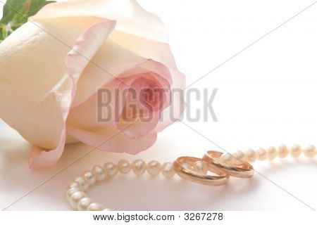 Wedding Rings, Pearl Beads And Rose, Isolated