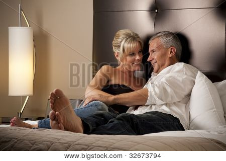 Man and Woman Relaxing in a Hotel Room