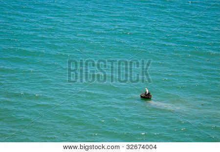 Lonely fisherman on Quy Nhon sea