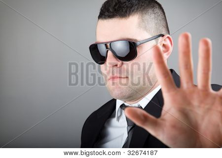 Secret agent making stop with his hand