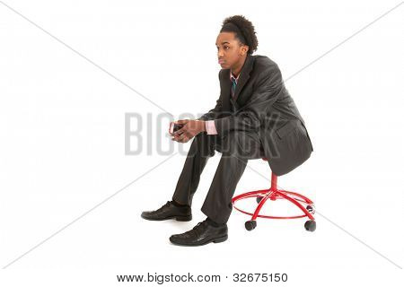 Young black business man with mobile phone in hands is thinking